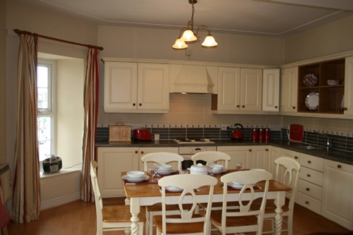 Above Cot, Kitchen and dining area, Lakes Cottage Holidays