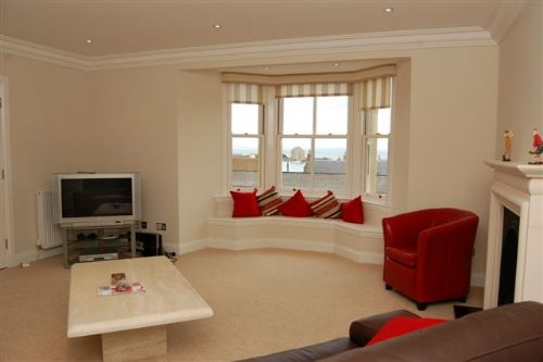 Sitting room with bay window views over to harbour