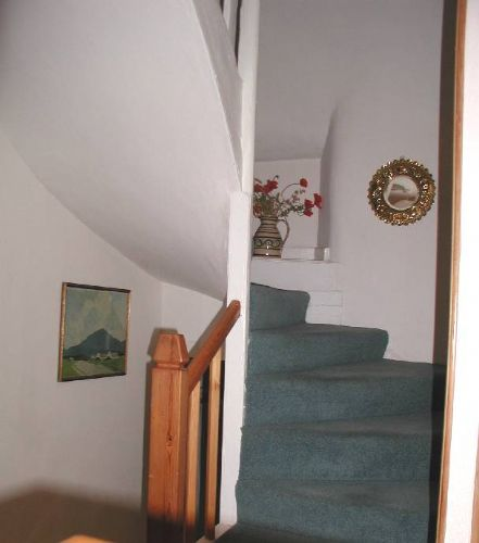 Stairs leading up to double and twin rooms