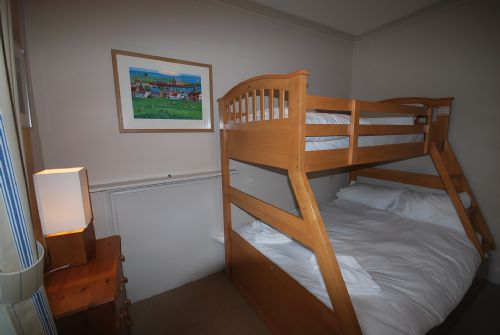 Double bedroom with bunk bed above