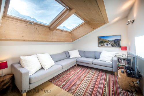 Lounge on top floor is bright and airy, with views of Mont Blanc