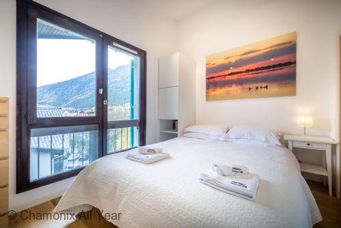 Double bedroom has large windows to enjoy the mountain views