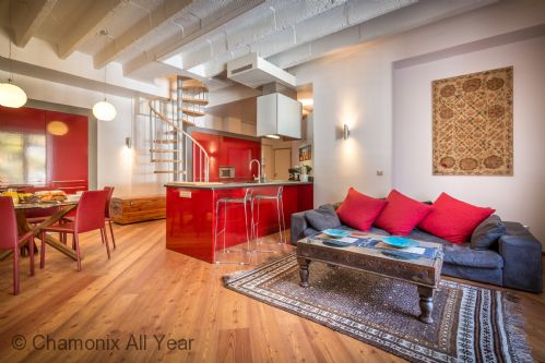 Open-plan living area benefits from high ceilings