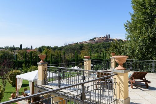 Terrace with views of Tuscan hill town and Montechio castle