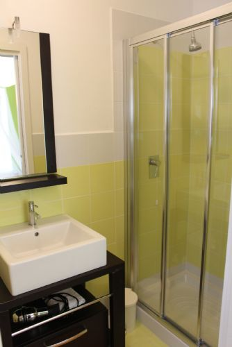 Four bathrooms, this one is ensuite on the ground floor. Bright clean and shiney