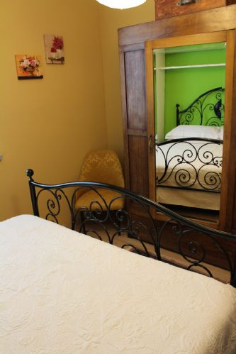 Large bedroom furnished with a combination of modern and antique furniture