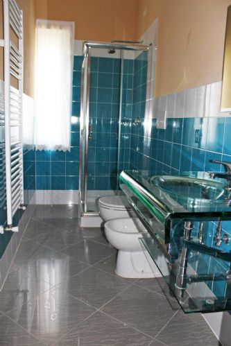 Upper floor bathrooms, two  with glass sink and showers