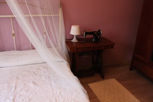 Details of bedrooms, modern and antique features