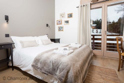 Master bedroom on main level with terrace access