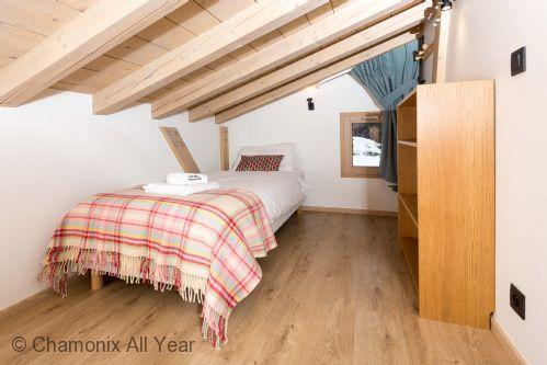 Second single bed in mezzanine bedroom