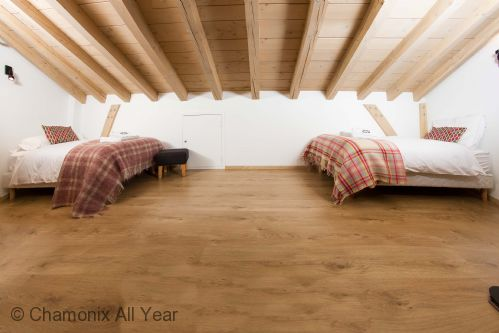Mezzanine twin bedroom under the eaves - great for kids!