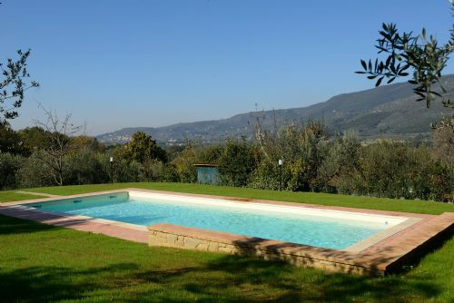 THe pool sits in the centere of a huge fenced garden and enjoys the views of the surrounding countryside