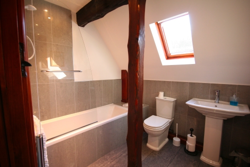 Family bathroom, shower over bath, whb & wc
