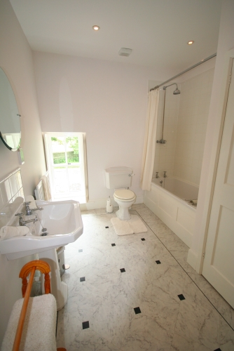1st floor, second family bathroom, bath with shower over