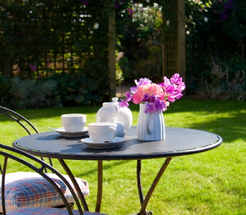 Alfresco dining in the beautiful enclosed rear garden....