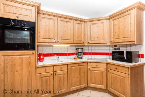 Kitchen is well-equipped with many compact appliances