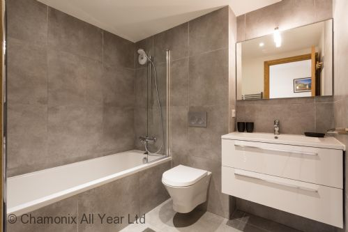 Family bathroom with bath, overhead shower & WC