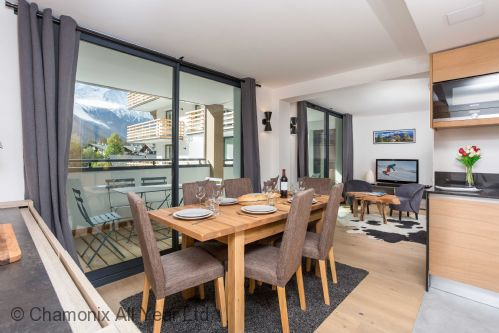 Dining table with balcony access and great south-facing views