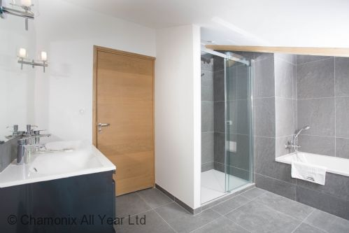 Family bathroom for second and third bedrooms with bath and Italian shower