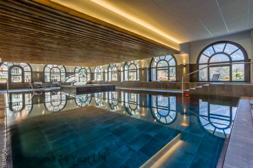 Heated indoor pool with cushions and seating