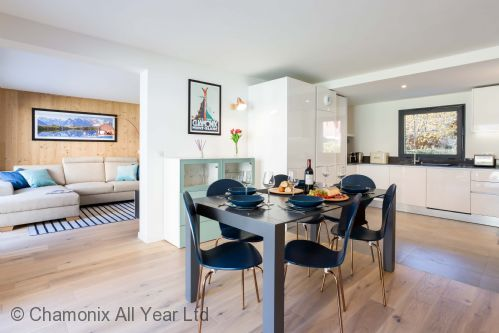 Interconnecting kitchen, living and dining areas in spacious apartment