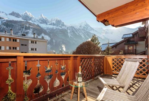 Master bedroom enjoys sunny private balcony with Mont Blanc views