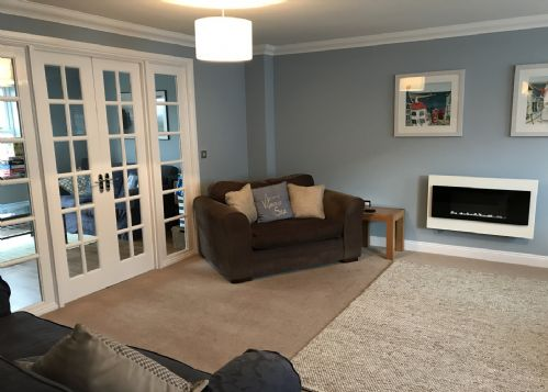Large lounge at front of property, double doors to family snug