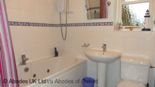 Shared bathroom with spa bath and overhead shower