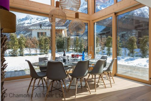 Dining area with extra high windows - let the mountains come to you