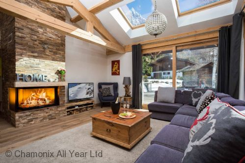 Large lounge with log fire, leading onto terrace with hot tub