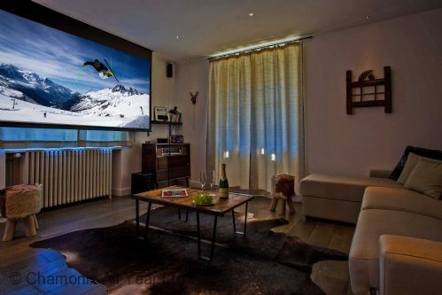 Lounge area with Cinema screen and projector for movie nights