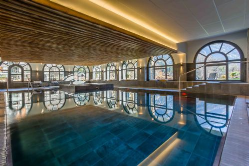 Communal Heated indoor pool with seating