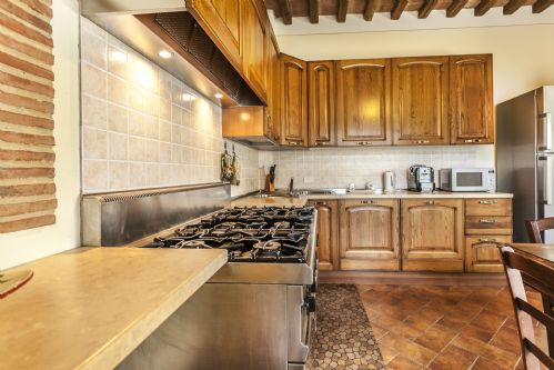 Large kitchen with cooking range, modern amenities