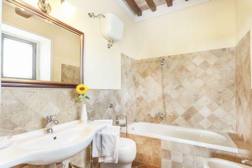 Each bedroom has its own bathroom, this one has a bathtub