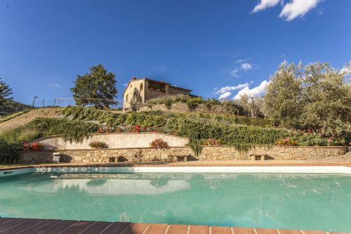 THe pool sits below the large villa with views of valley