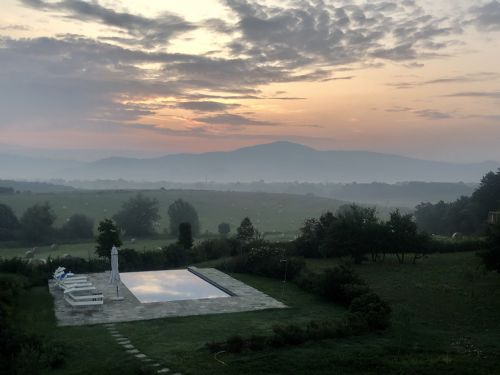 Dusk from the master-bedroom, overlooking pool