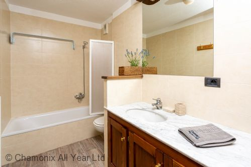 Family bathroom with washing machine
