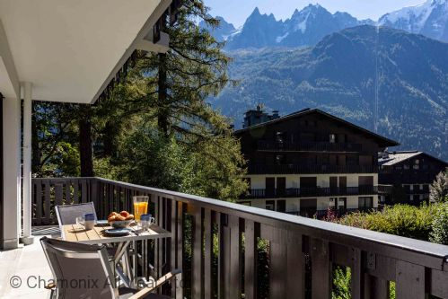Large balcony with mountain views
