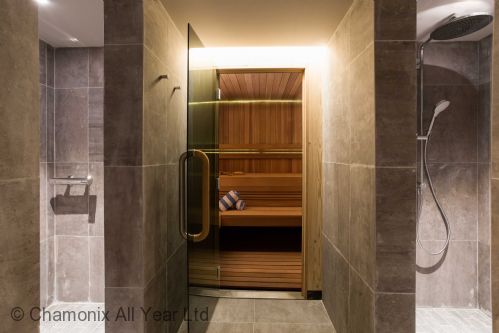 Sauna is spacious and has showers adjacent