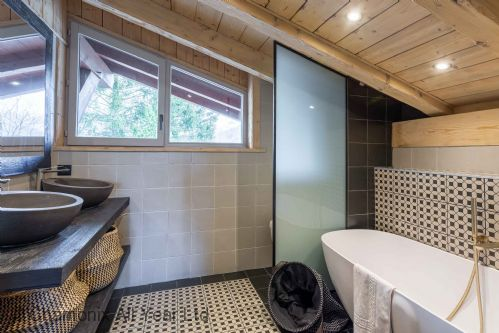 Bedroom four's ensuite has a bathtub, WC and double sink