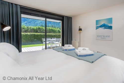 Master bedroom with ensuite and patio doors