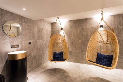 If you have to wait for the sauna, grab a seat in an 'egg'