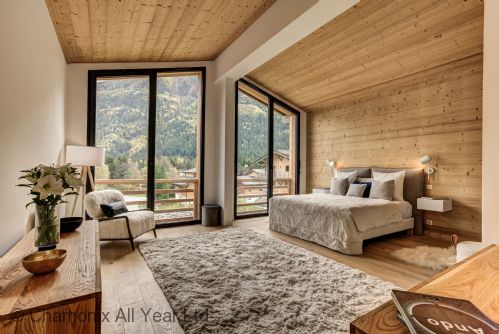 Master suite with floor to ceiling windows and private balcony
