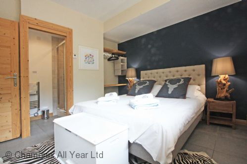 Downstairs king bedroom with ensuite shower