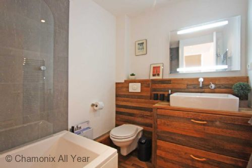 Family bathroom with bath and overhear shower