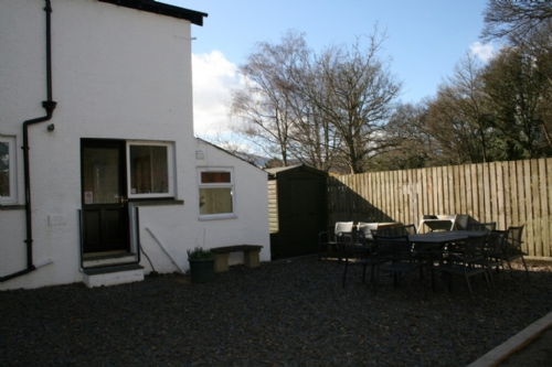 Riverdale, garden seating area, Lakes Cottage Holidays