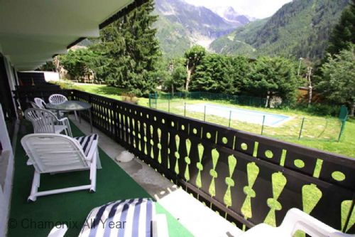 Balcony overlooking pool and Grands Montets