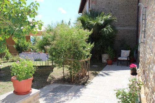 Garden area and entrance to villa
