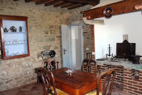 second dining area, with lots of Tuscan style and fireplace