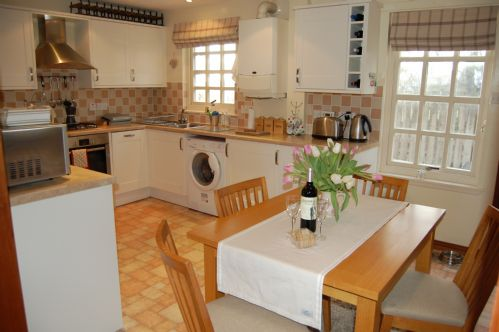Well equipped kitchen with door to patio